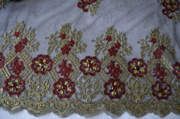 black, red and gold spanish style lace